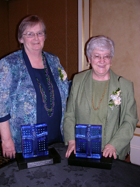 Letty and Mary Gene receiving award for Outstanding Service NCCA